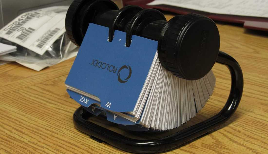 Image of a rolodex. The history of expert networks starts with firms collecting large rolodexes.