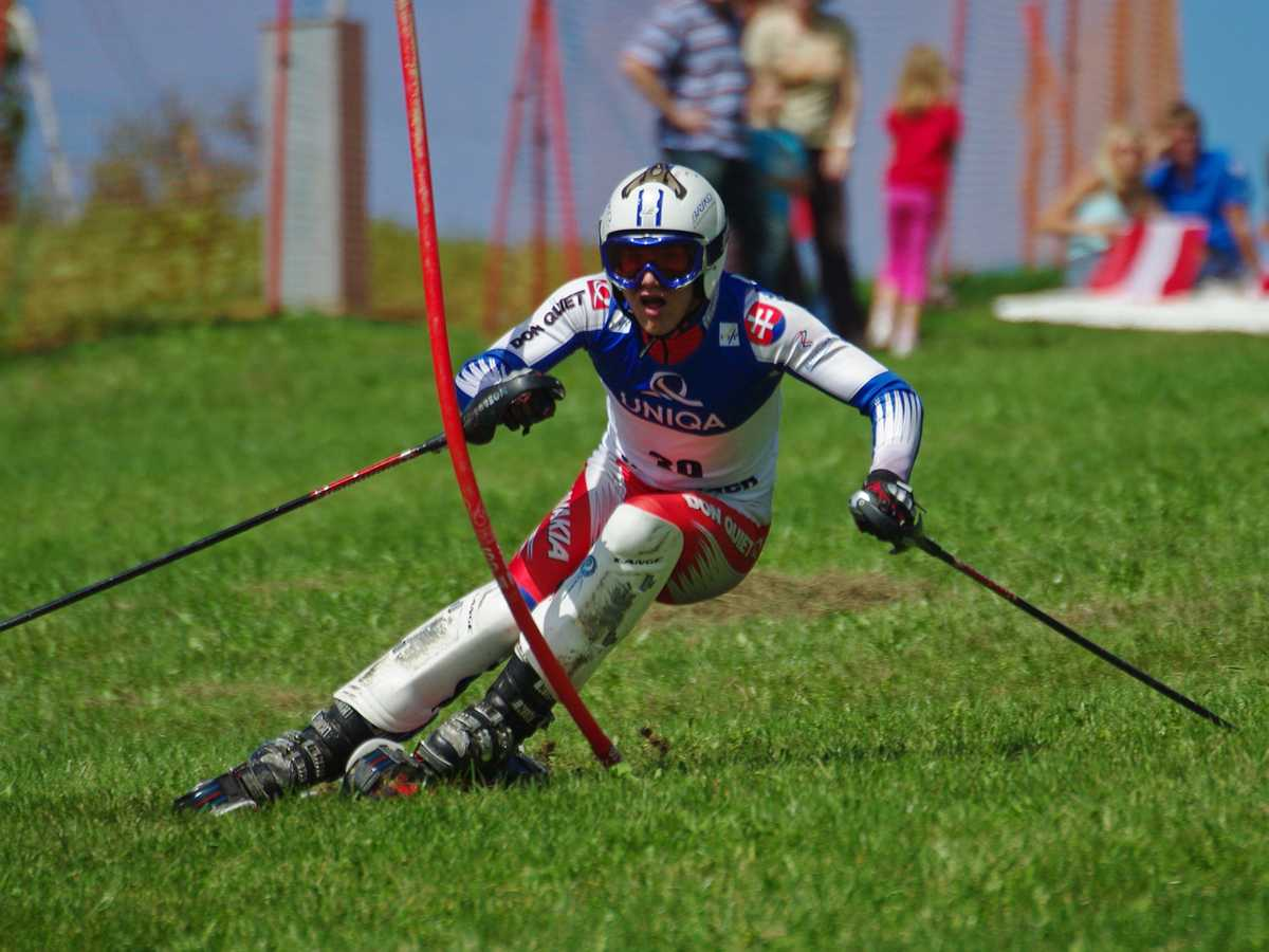 Picture of a man skiing on grass, a high-friction sport.